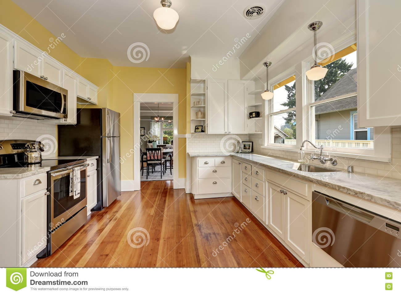 kitchen interior with white cabinets yellow walls and wood floor stock photo image of. Black Bedroom Furniture Sets. Home Design Ideas
