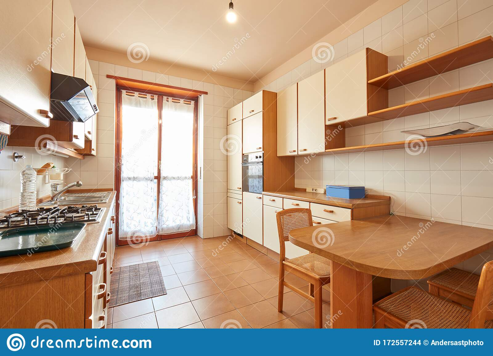 Kitchen Interior With Wooden Table In A Sunny Day In Normal ...