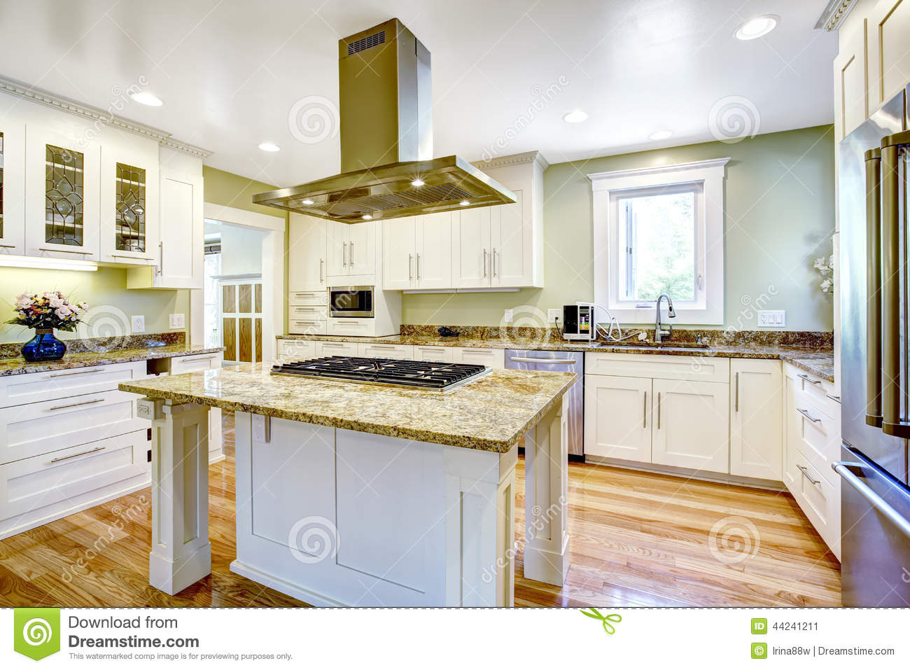 kitchen island with built-in stove, granite top and hood stock