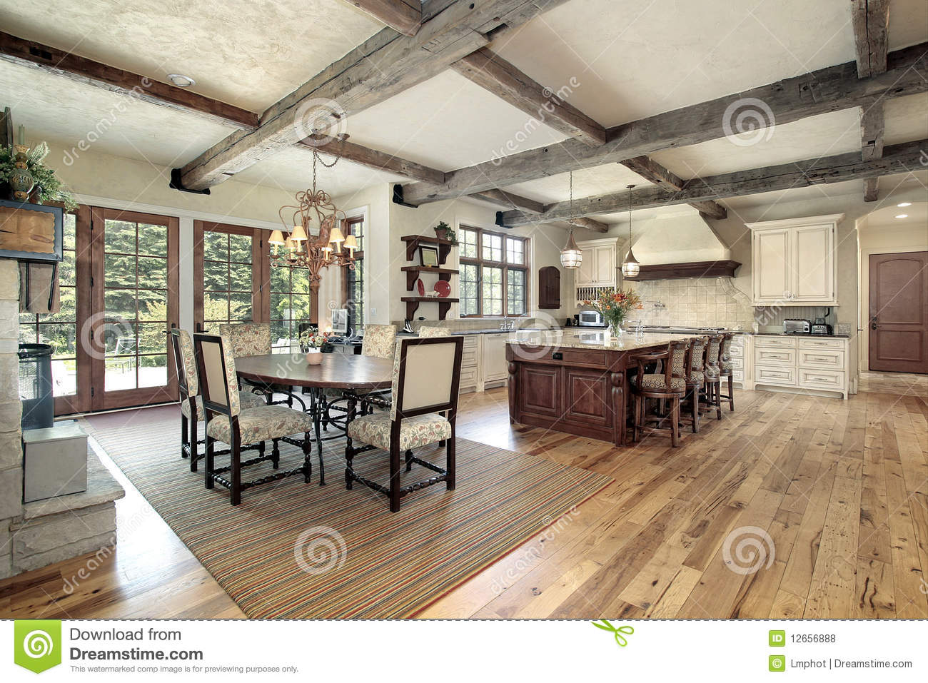 Kitchen With Island And Ceiling Wood Beams Stock Photo