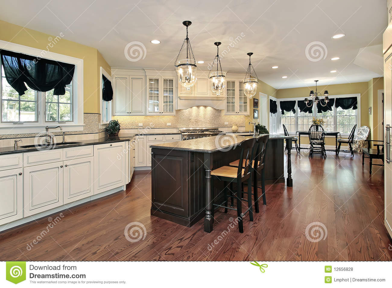 Kitchen with island and eating area royalty free stock photos image 12656828 for Eat in kitchen designs for small kitchen