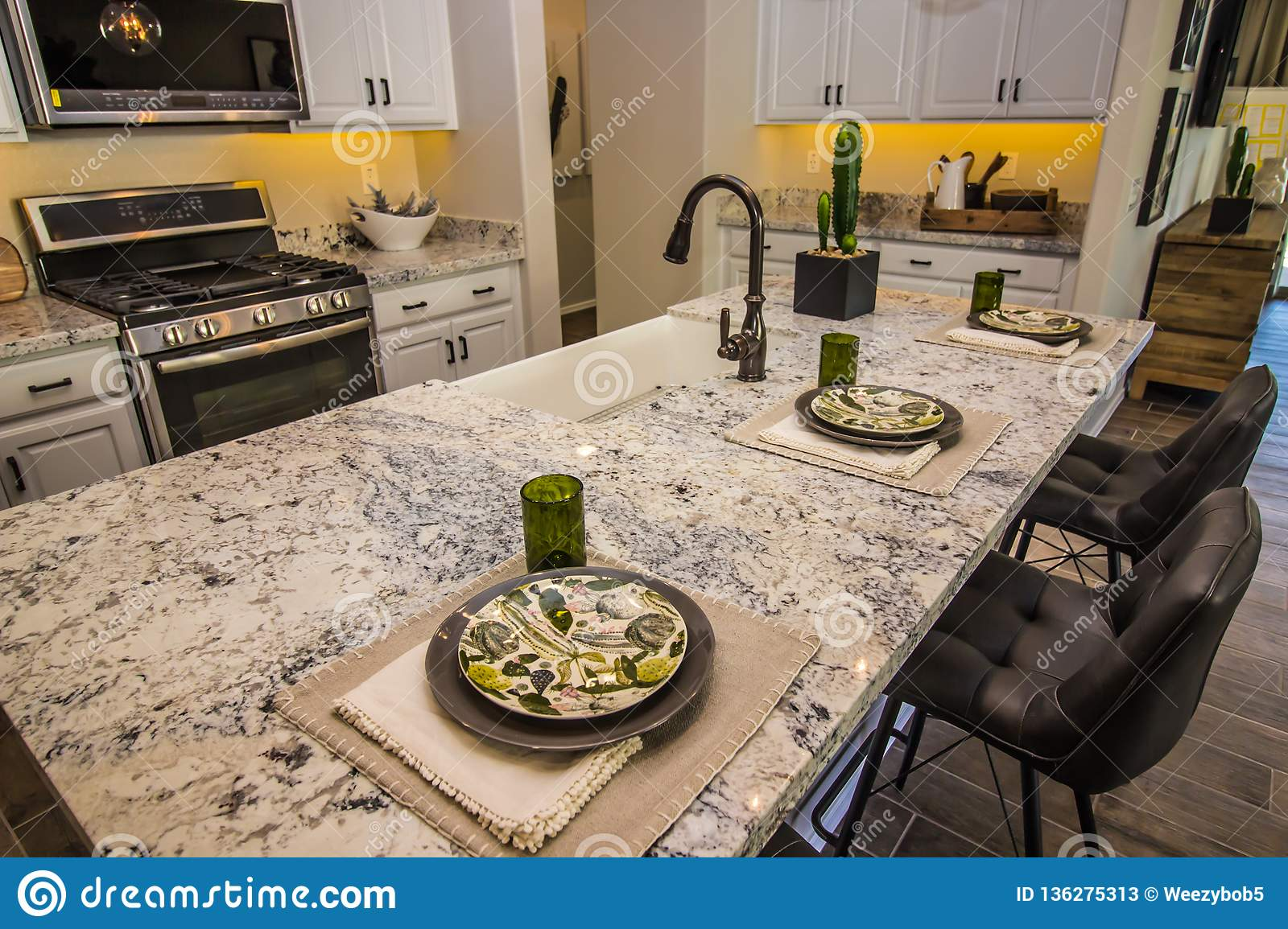 Kitchen Island With Granite Counter Top And Place Settings