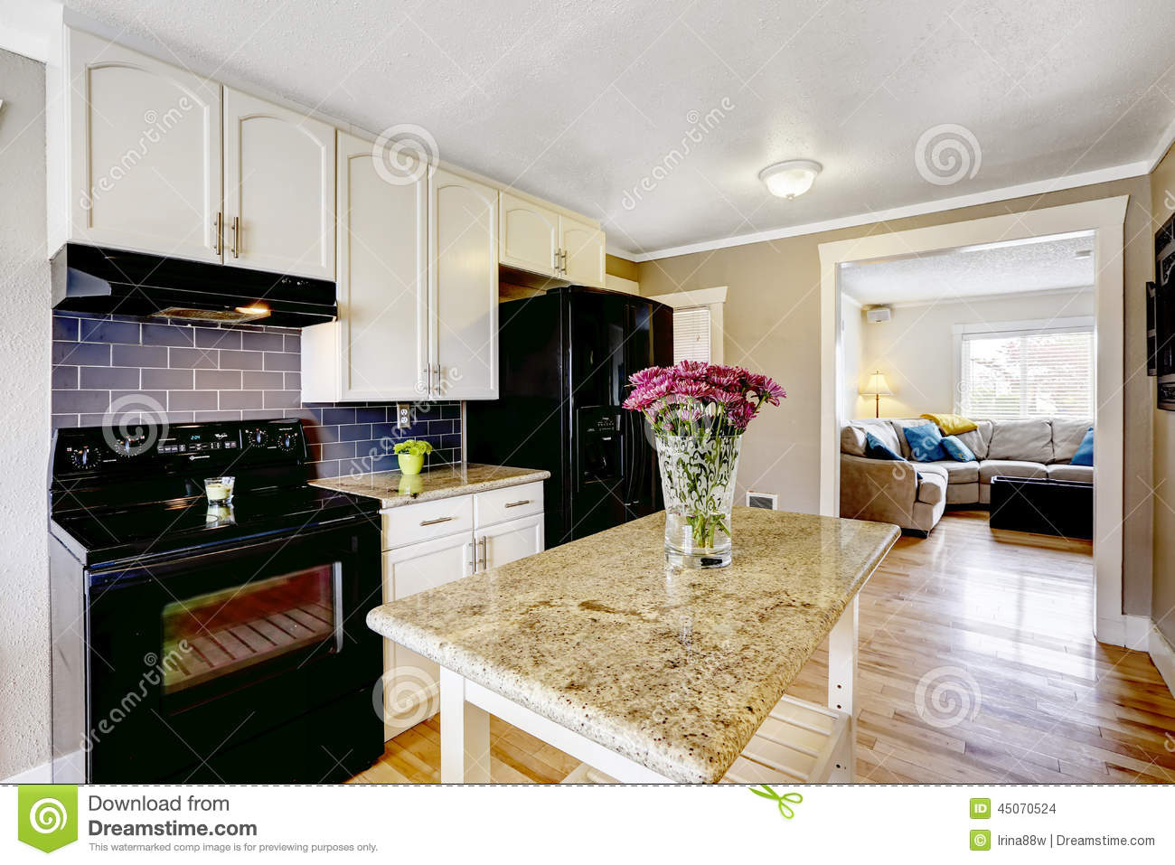 White Kitchen Island With Granite Top Kitchen Island With Granite Top And Flowers Stock Photo Image