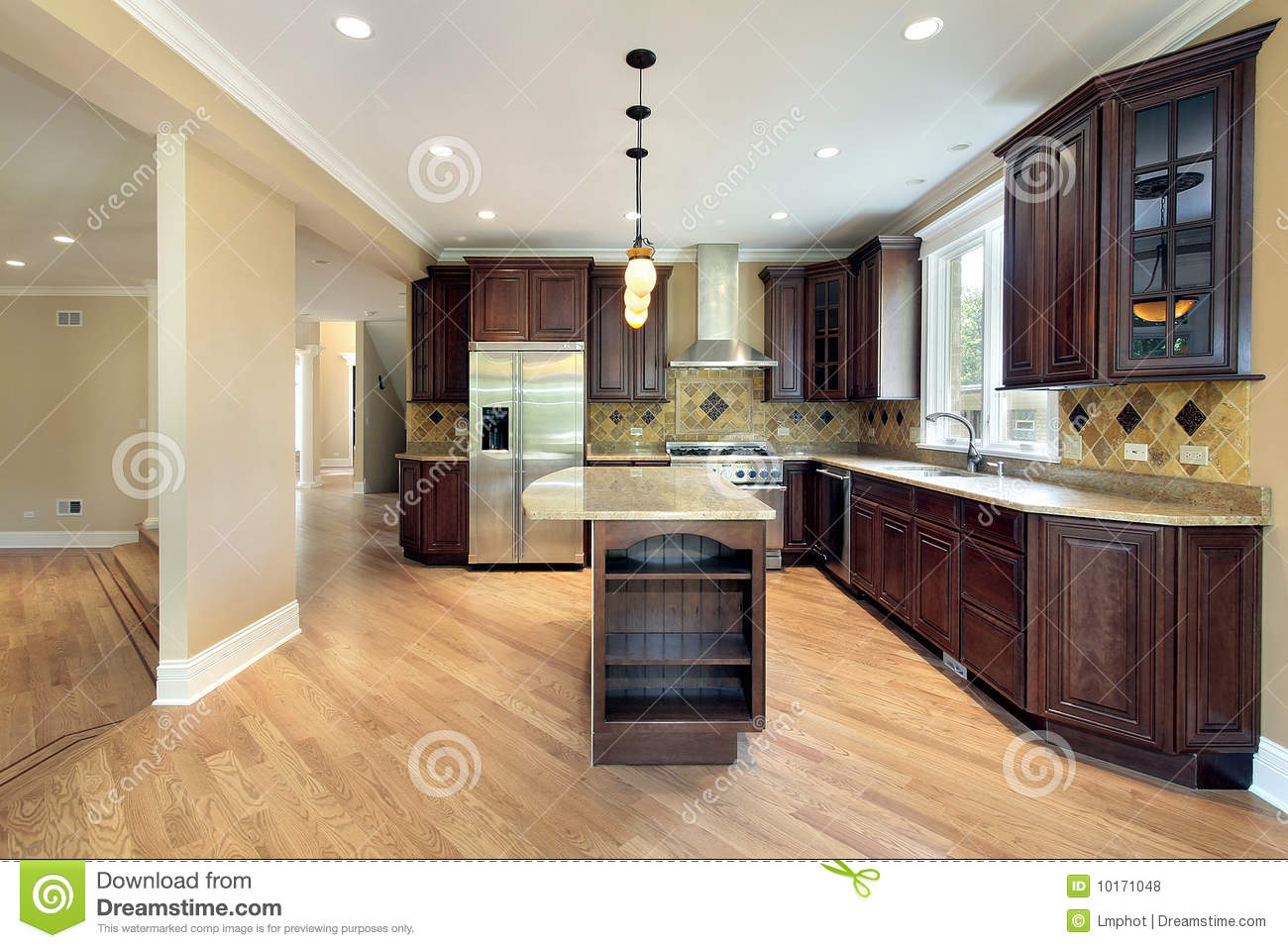 Kitchen and island in new construction home royalty free for Building a new kitchen