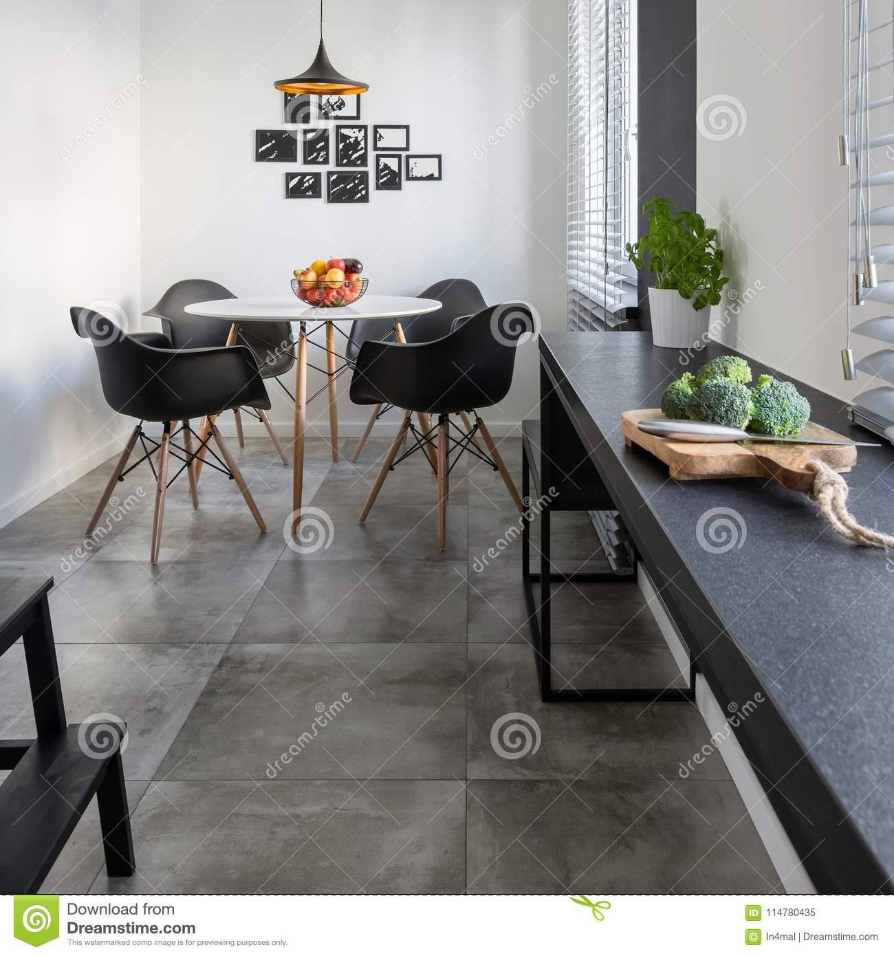 Kitchen Interior With Pink Furniture And Tiles Stock: Kitchen With Long, Granite Countertop Stock Image