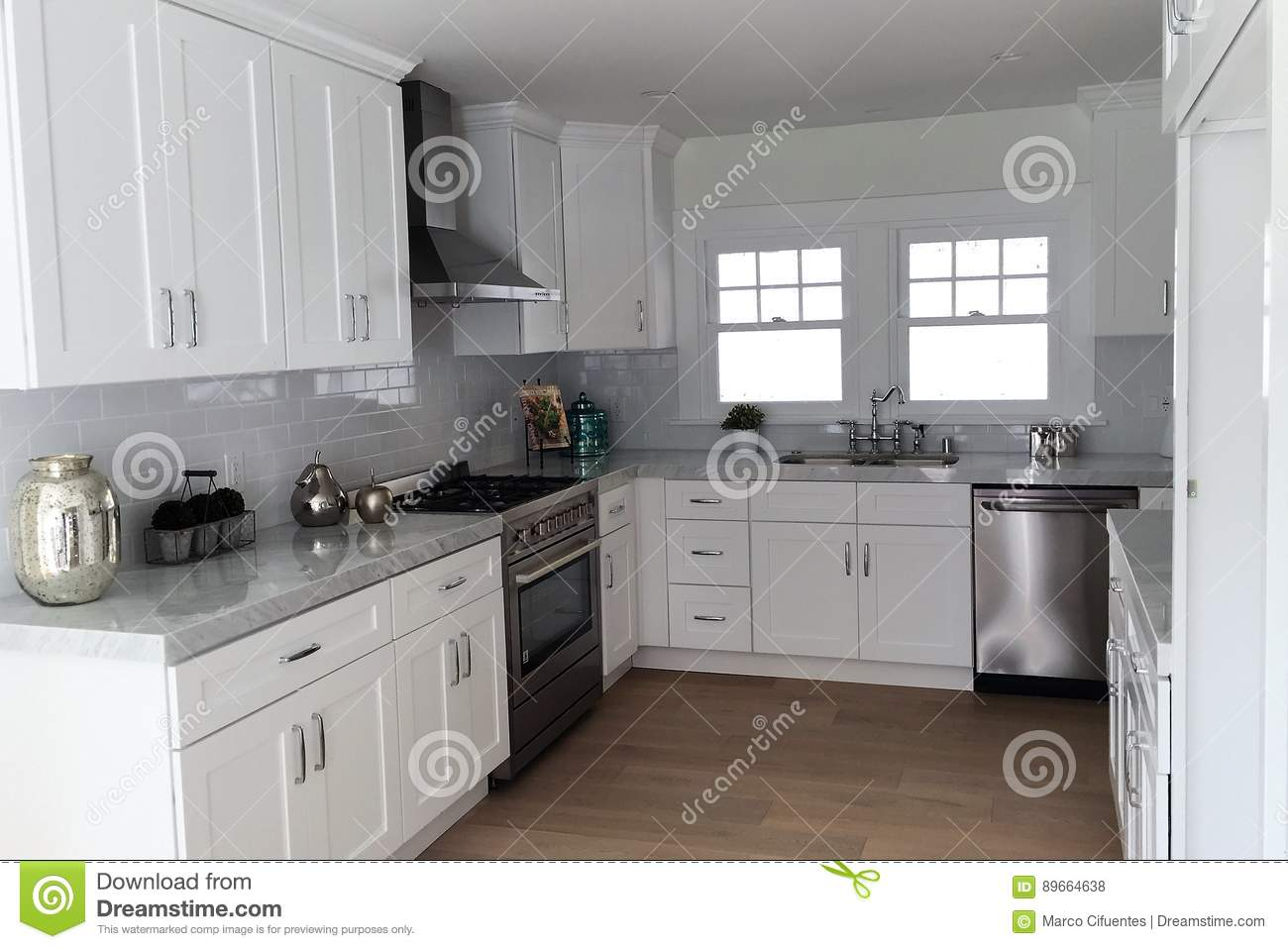 Genial Marbel Countertops, White Cabinetes And Stainless Steel Appliances