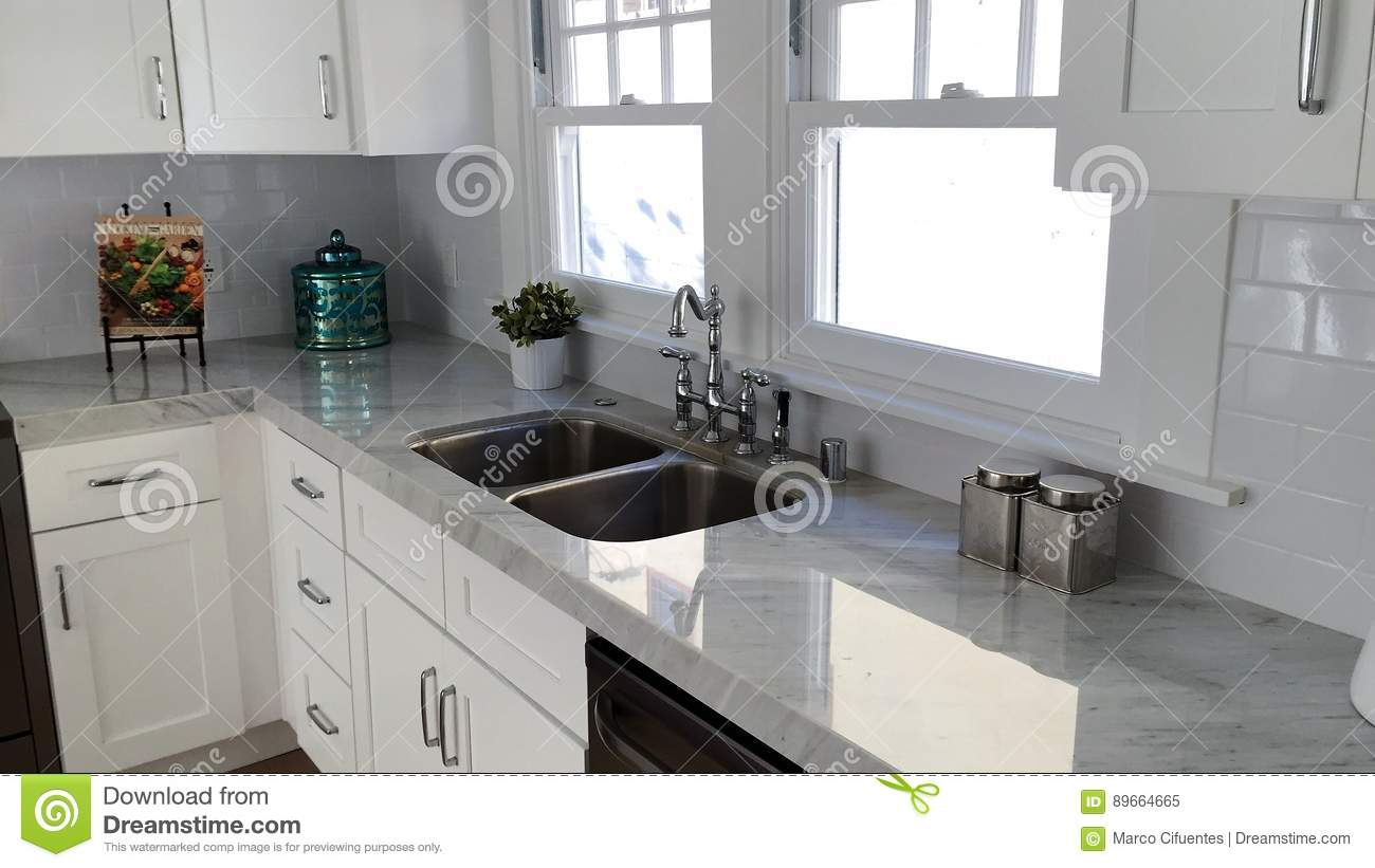 Gentil Marbel Countertops, White Cabinetes And Stainless Steel Appliances