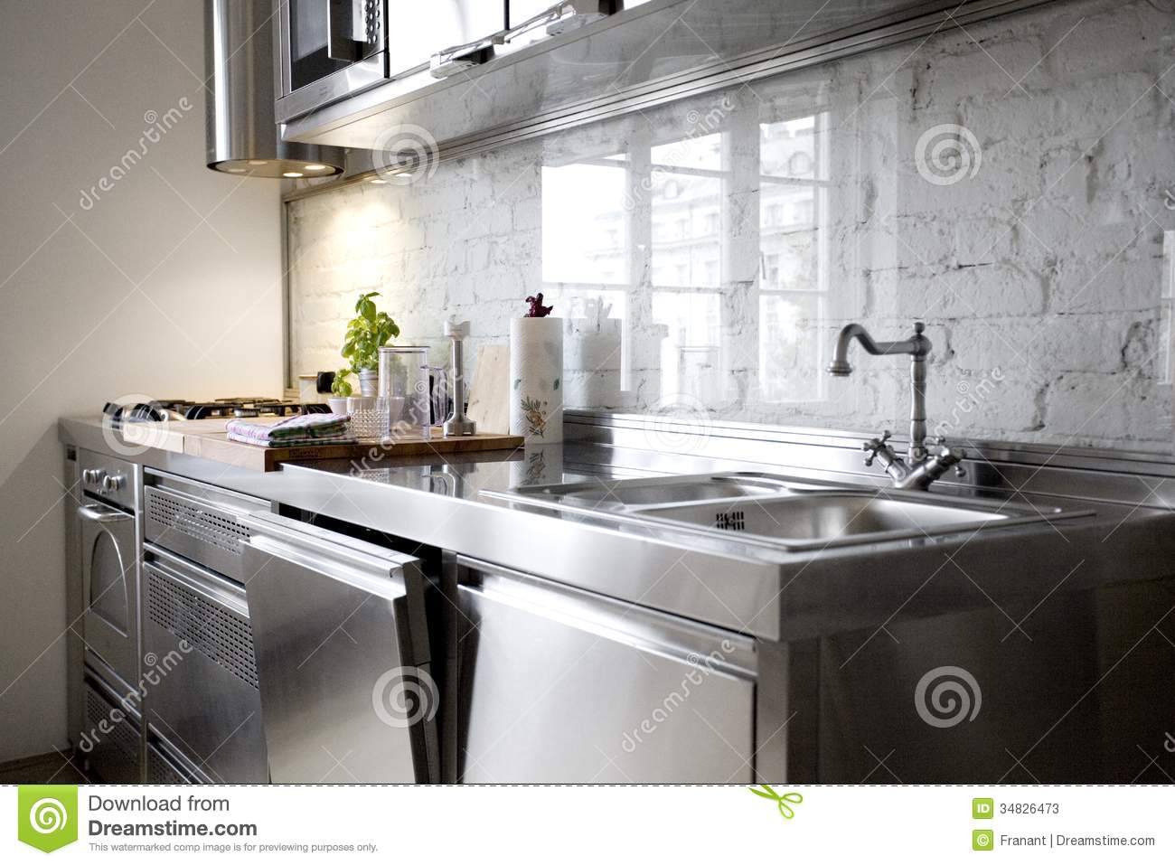 Modern Kitchen With Stainless Steel Appliances Stock