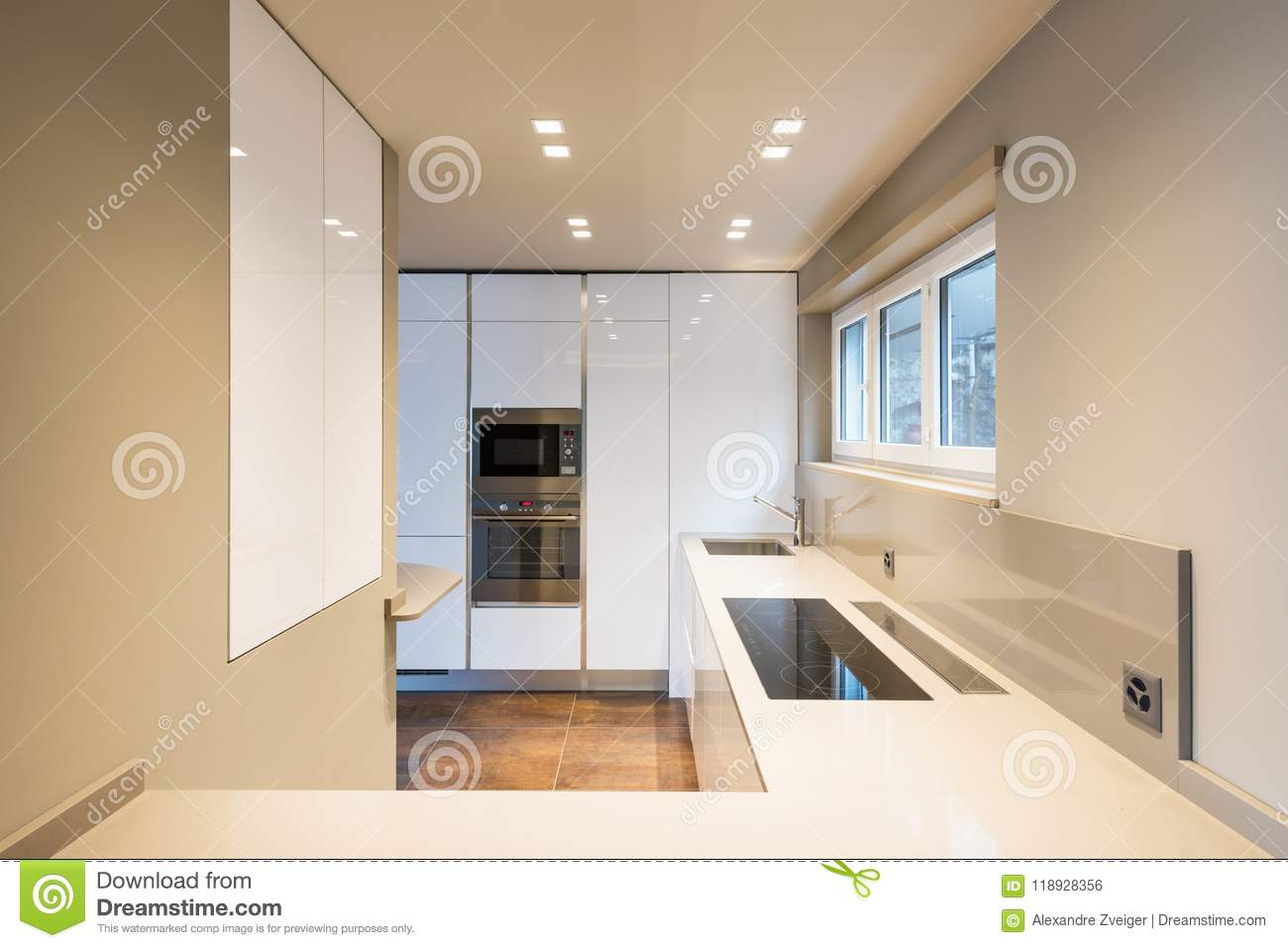 Kitchen with modern white furniture and latest generation appliances