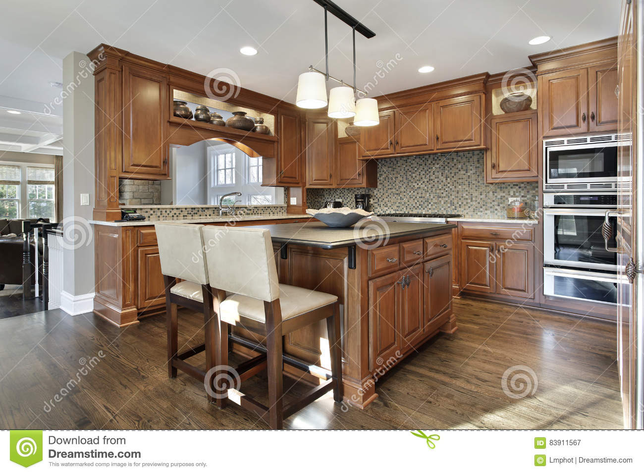 kitchen in luxury home with oak cabinets stock photo   Kitchen With Oak Wood Cabinetry Stock Image - Image of ...