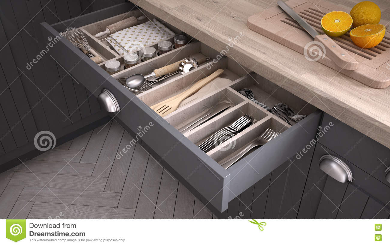 Kitchen opened drawer full of kitchenware