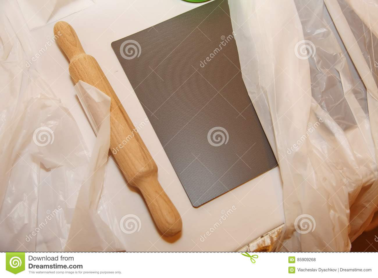 Wooden Rolling Pin For Rolling Dough In The Kitchen Stock Photo
