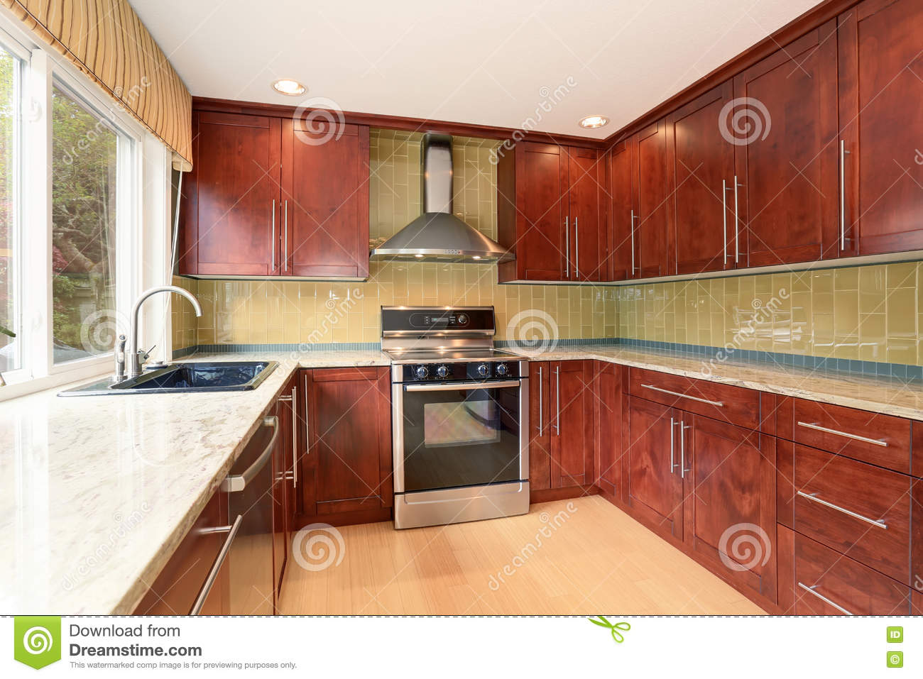 Kitchen Room Interior With Modern Brown Cabinets And Light