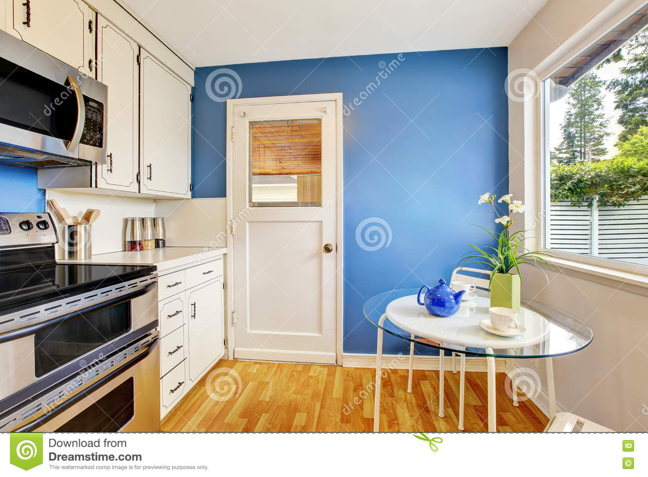 Kitchen room with white cabinets blue walls and glass for Kitchen white cabinets blue walls