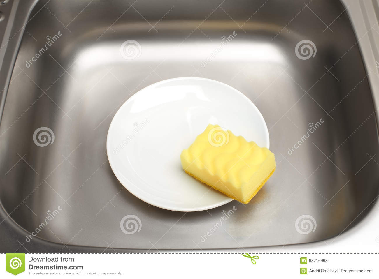 Kitchen Sink With Clean White Plate And Yellow Cleaning Sponge Stock ...