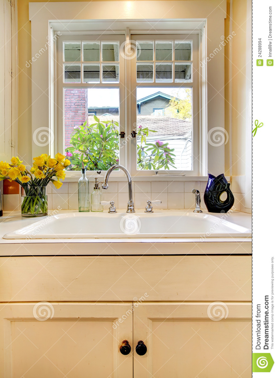 Kitchen Sink And White Cabinet With Window.