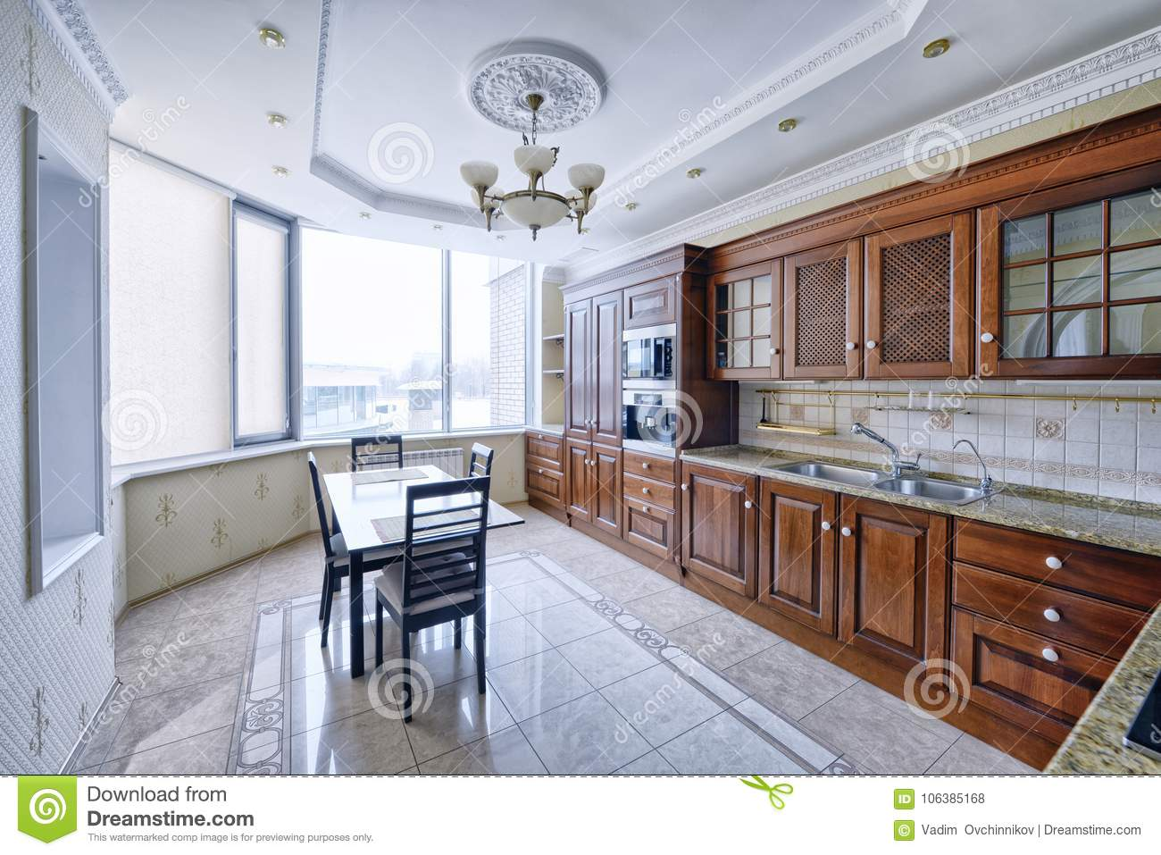 The kitchen is solid wood in a classic style in a modern house