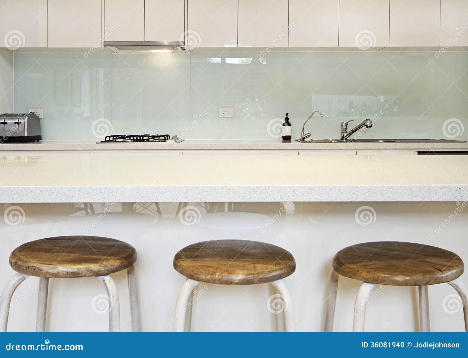 Kitchen benchtop, splashback and stools contemporary.