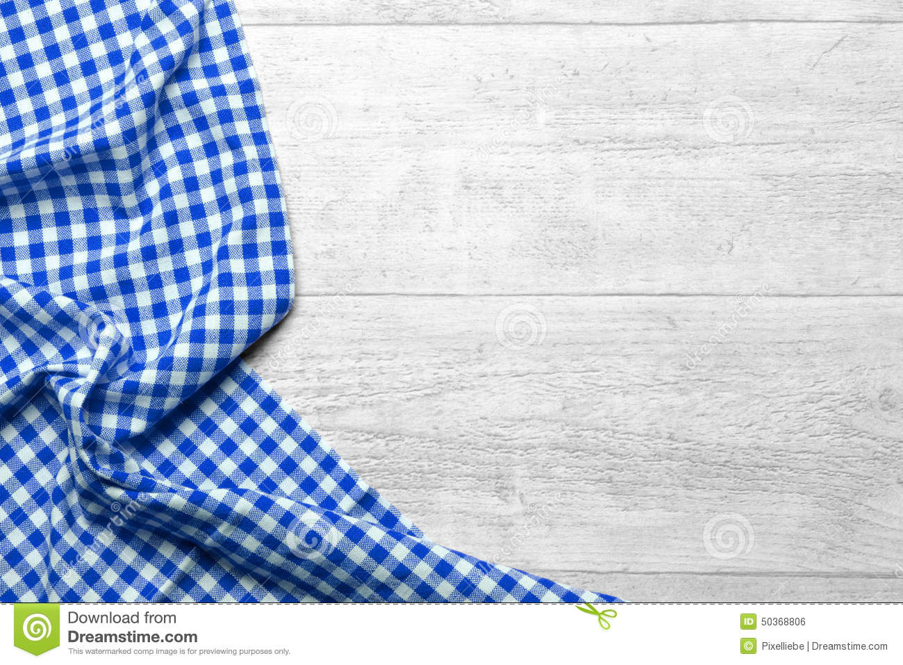 wooden background with a blue checkered tablecloth.