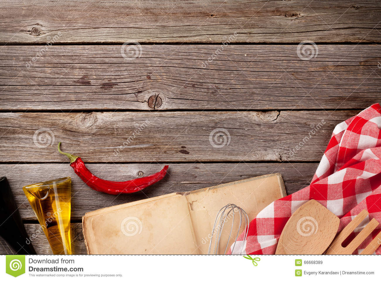 kitchen table with recipe book and ingredients stock photo - image