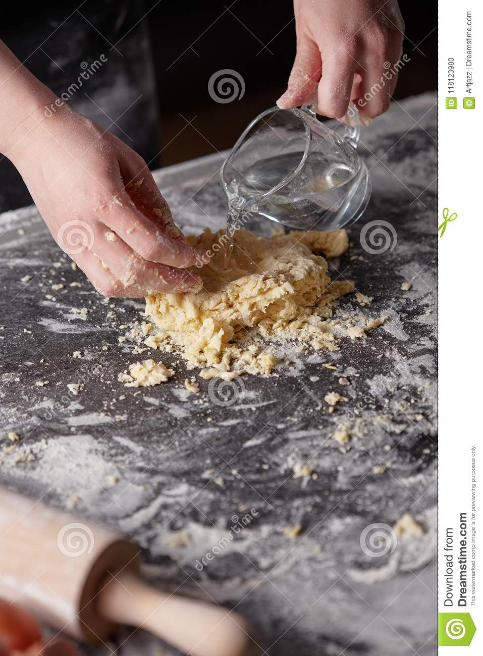Download On A Kitchen Table The Women`s Hands Kneads The Dough. Step-by-step Preparation Of The Dough Stock Photo - Image of baker, black: 118123980