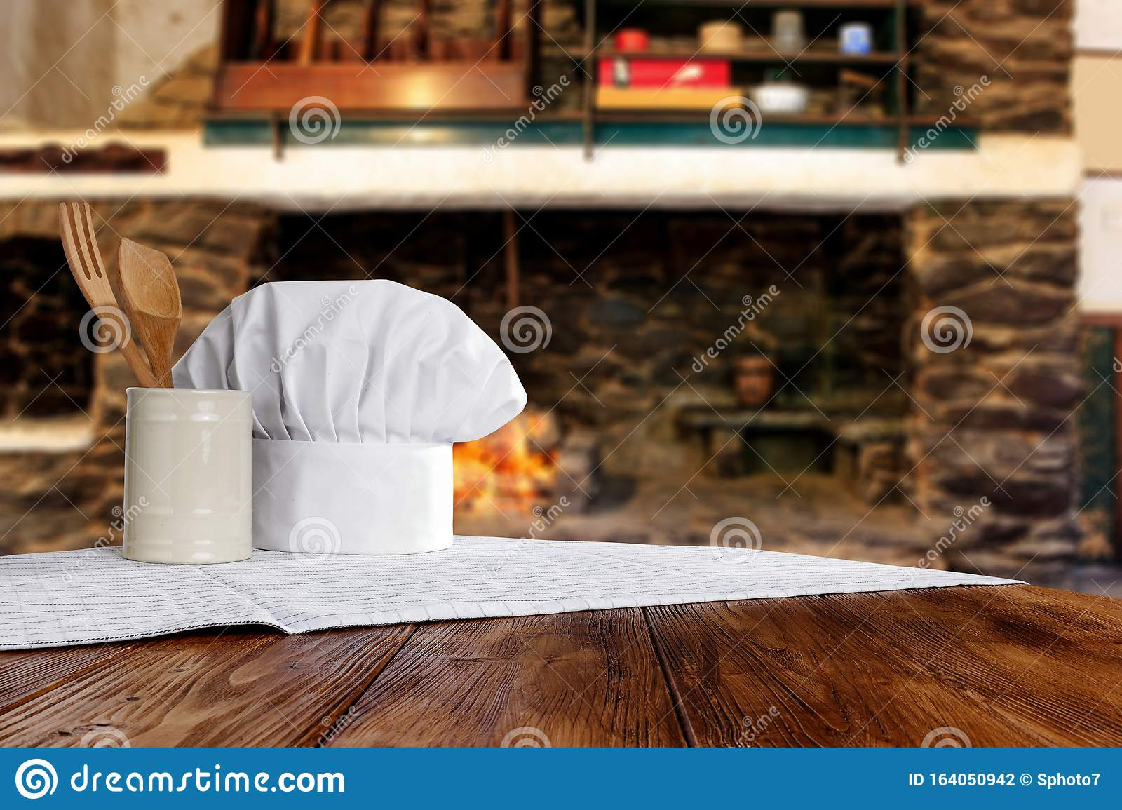 Kitchen Tools On Wooden Top With Cosy Warm Home Interior With Old Fireplace Wall Background Stock Photo Image Of Fire Heat 164050942