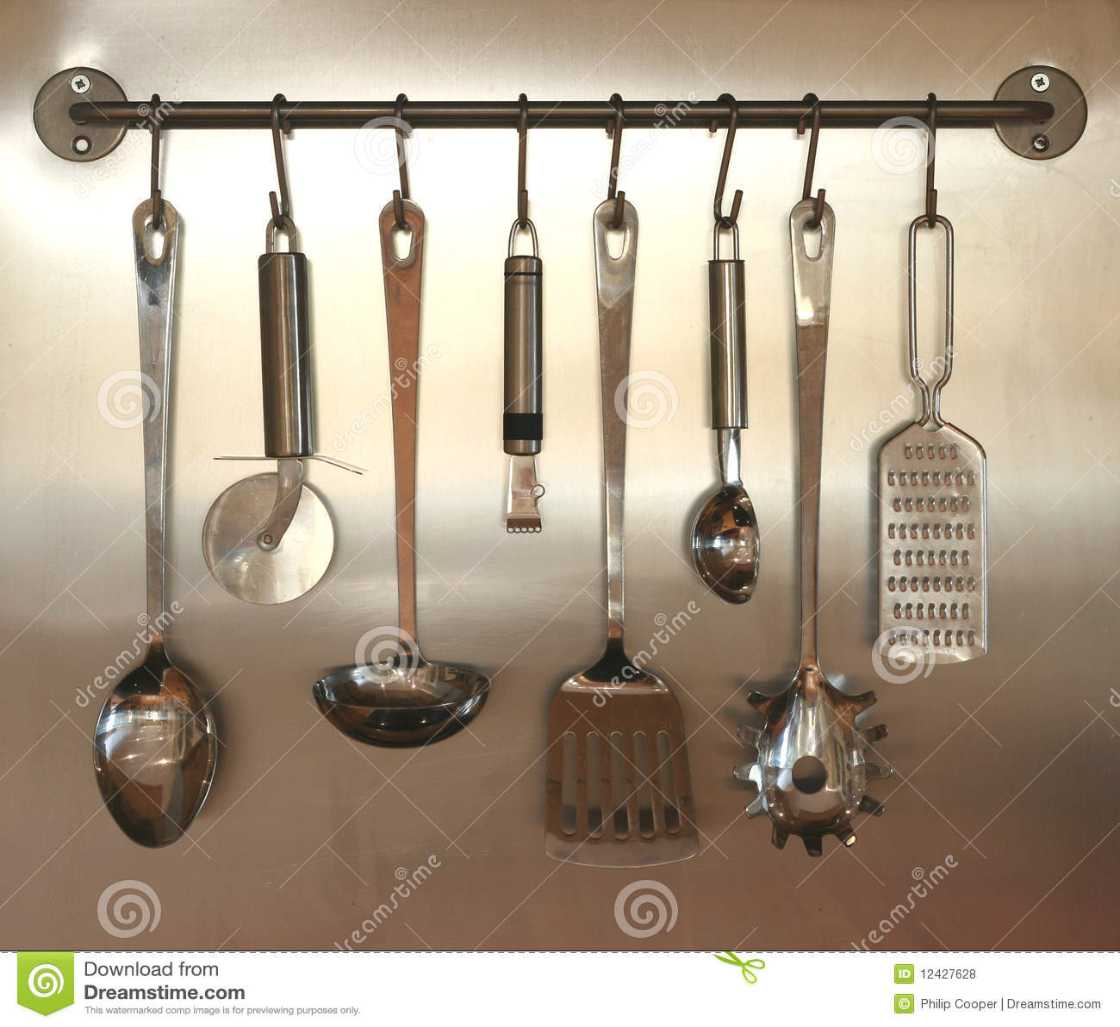 Good Kitchen Utensils Hanging On Wall Royalty Free Stock Photos