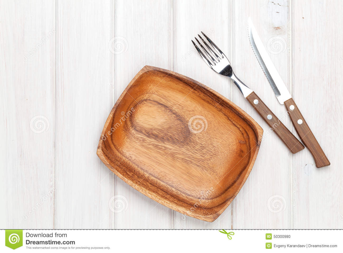 Kitchen utensils over white wooden table royalty free for Table utensils