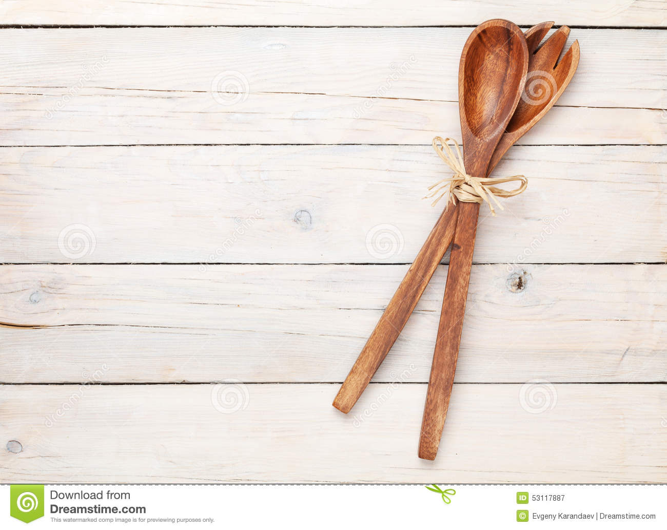 Kitchen utensils over white wooden table royalty free for Wooden tabletop kitchen