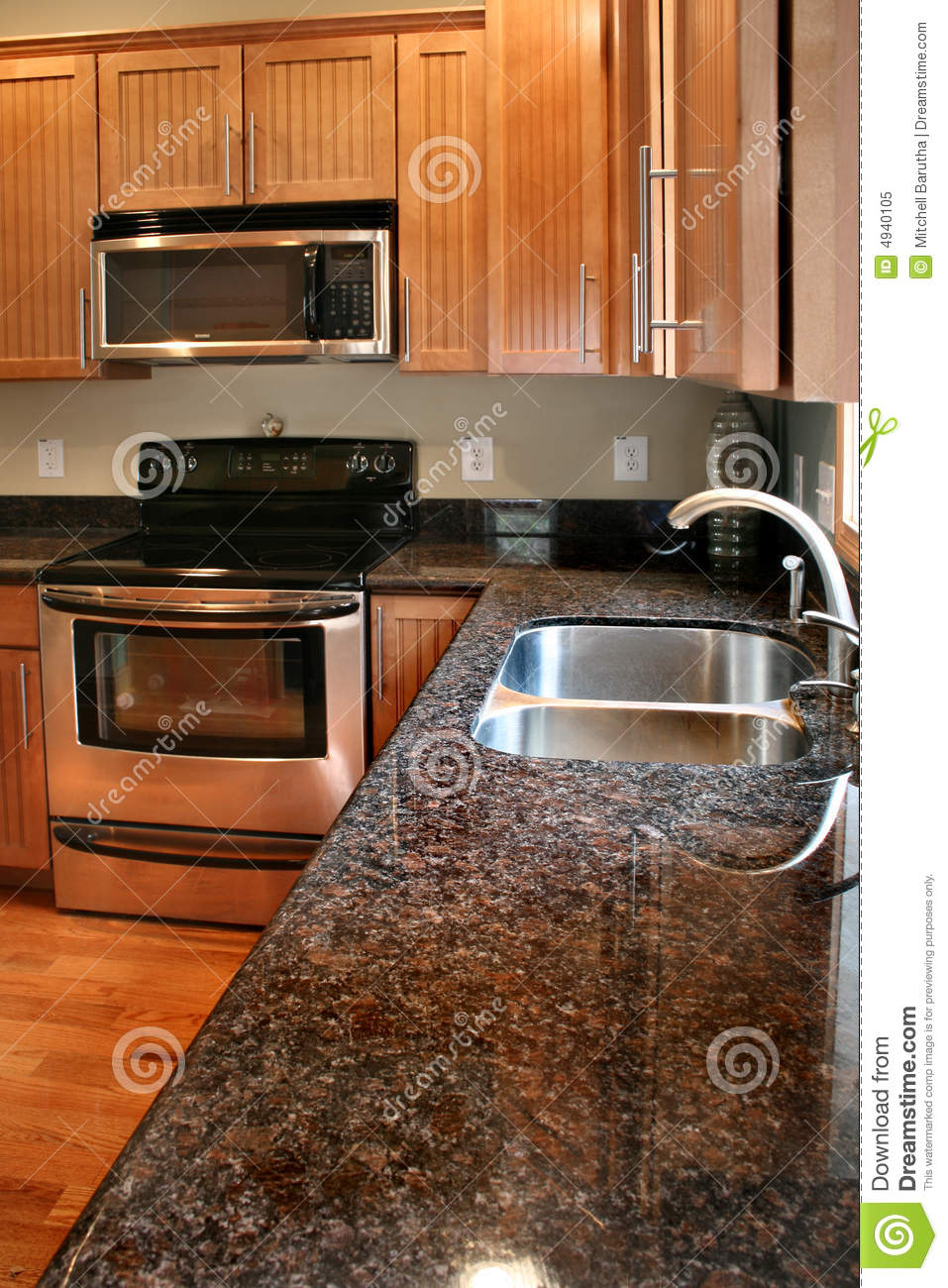 Kitchen Wood Cabinets Black And Stainless Stove Royalty Free Stock Photo - Image: 4940105