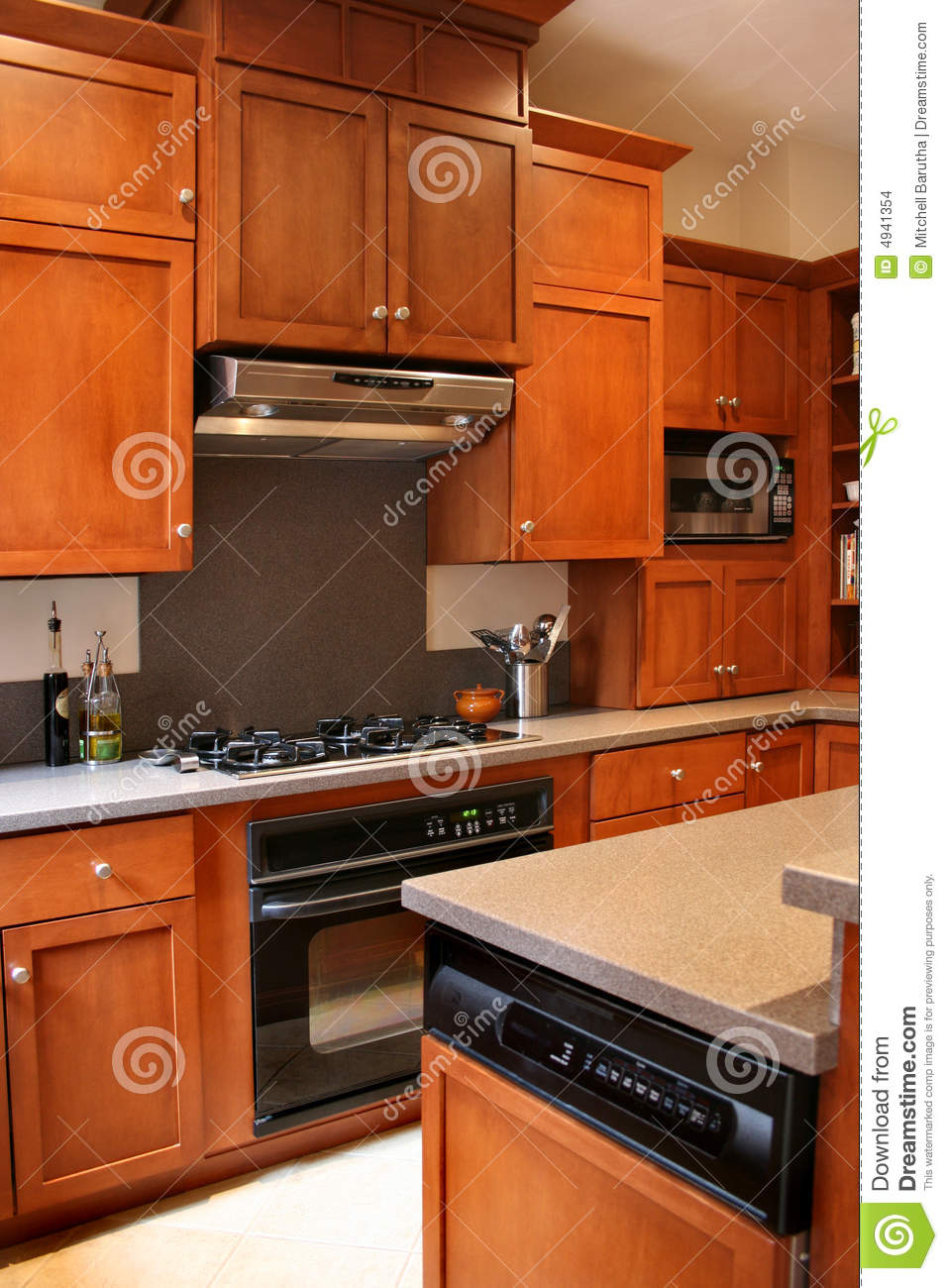 Kitchen wood cabinets black and stainless stove stock