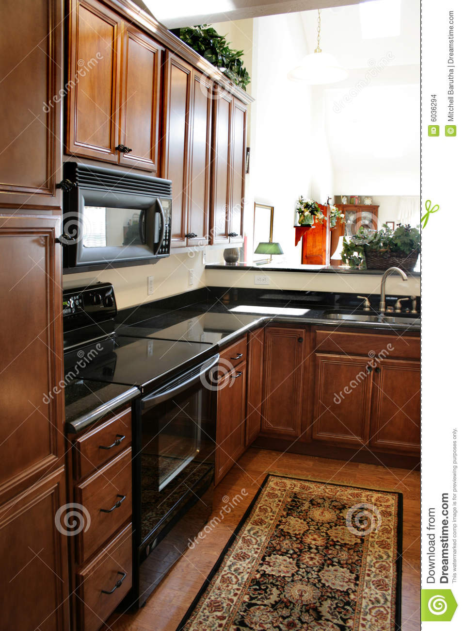Kitchen wood cabinets black and stainless stove stock - Black and wood kitchen ...