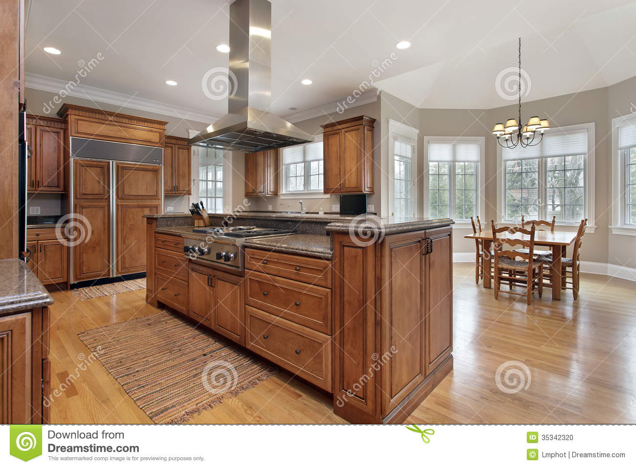 kitchen with wood and granite center island stock photo