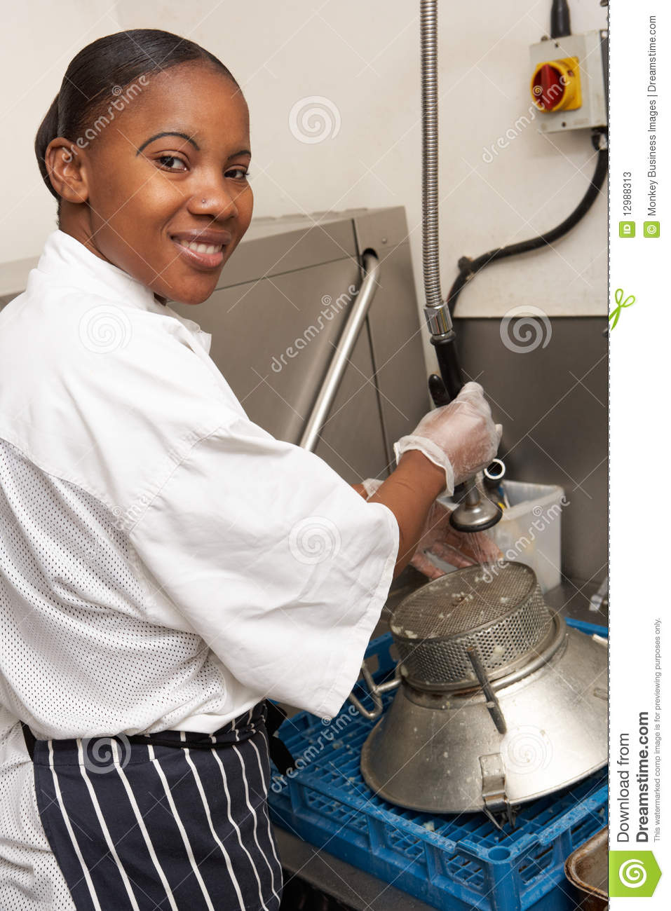 Kitchen Worker Washing Up In Restaurant Kitchen Stock