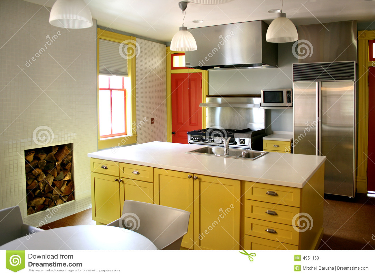 Kitchen yellow wood cabinets stainless stove stock image for Kitchen cabinets yellow
