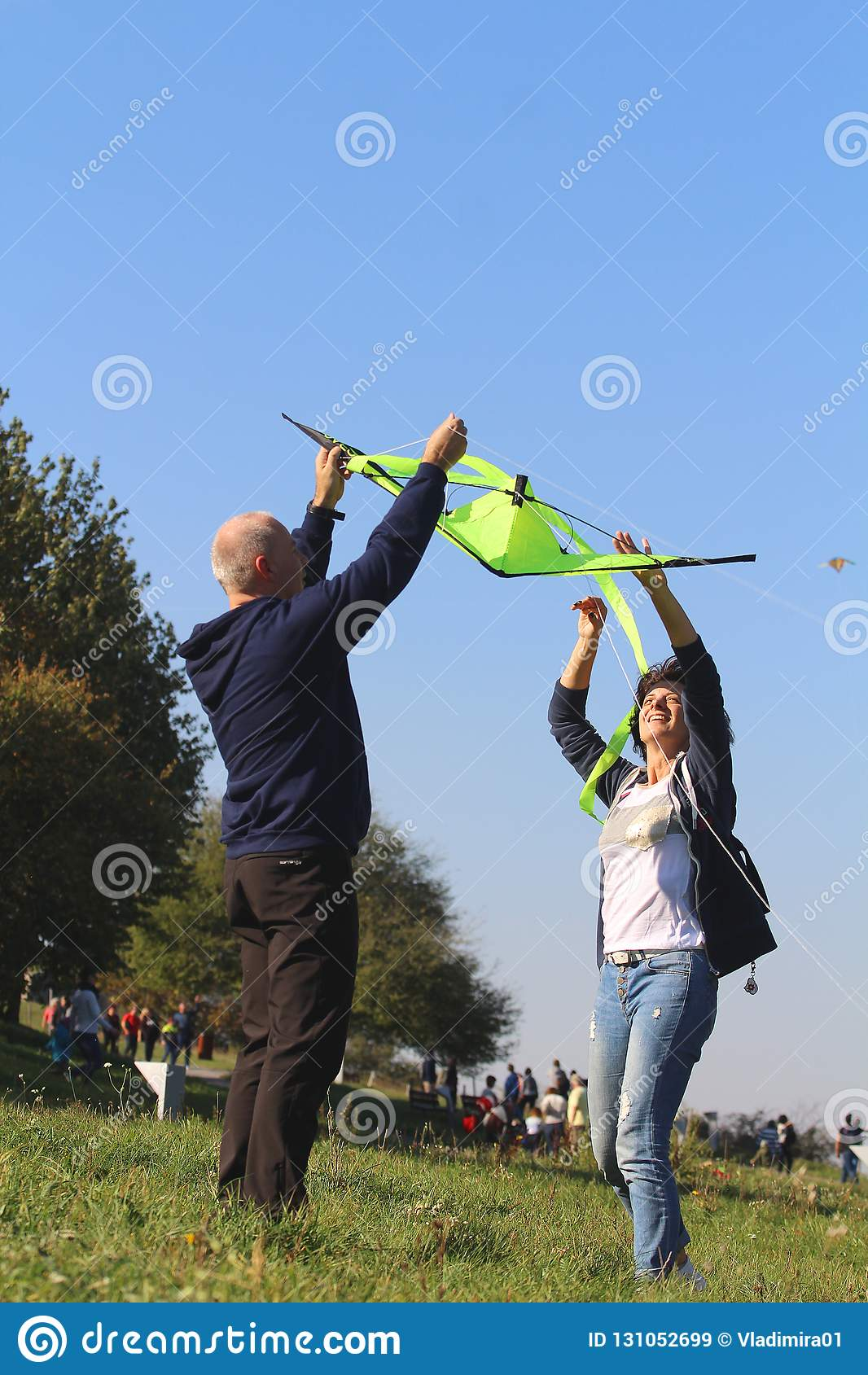 Kite festival - a couple preparing a kite