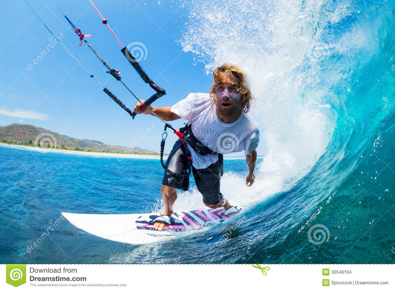 Extreme Sport, Kite Surfer Riding Wave getting Barreled.