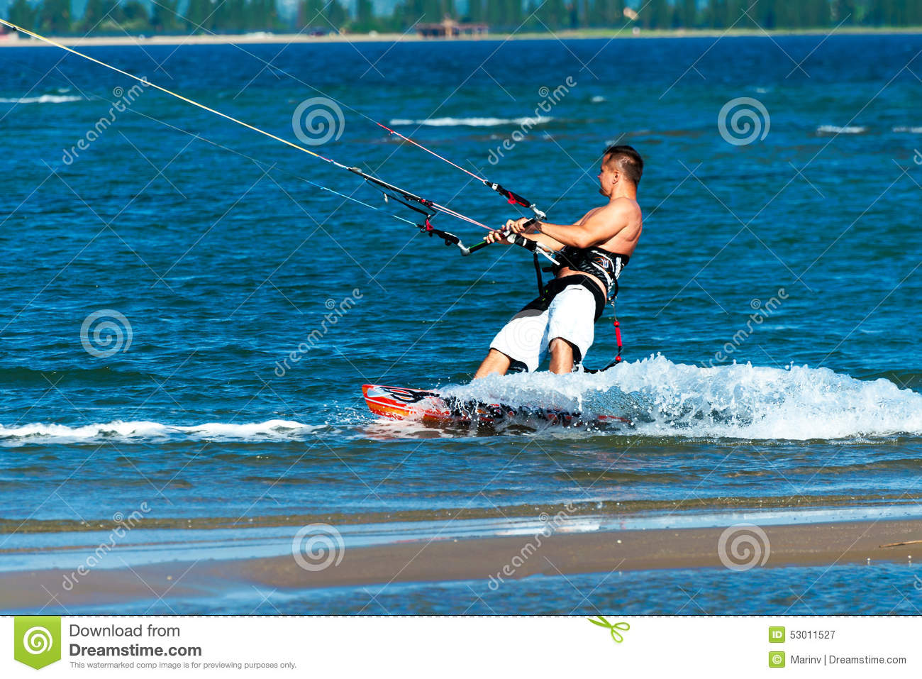 Kitesurfer rides on the surfboard and enjoys the sea