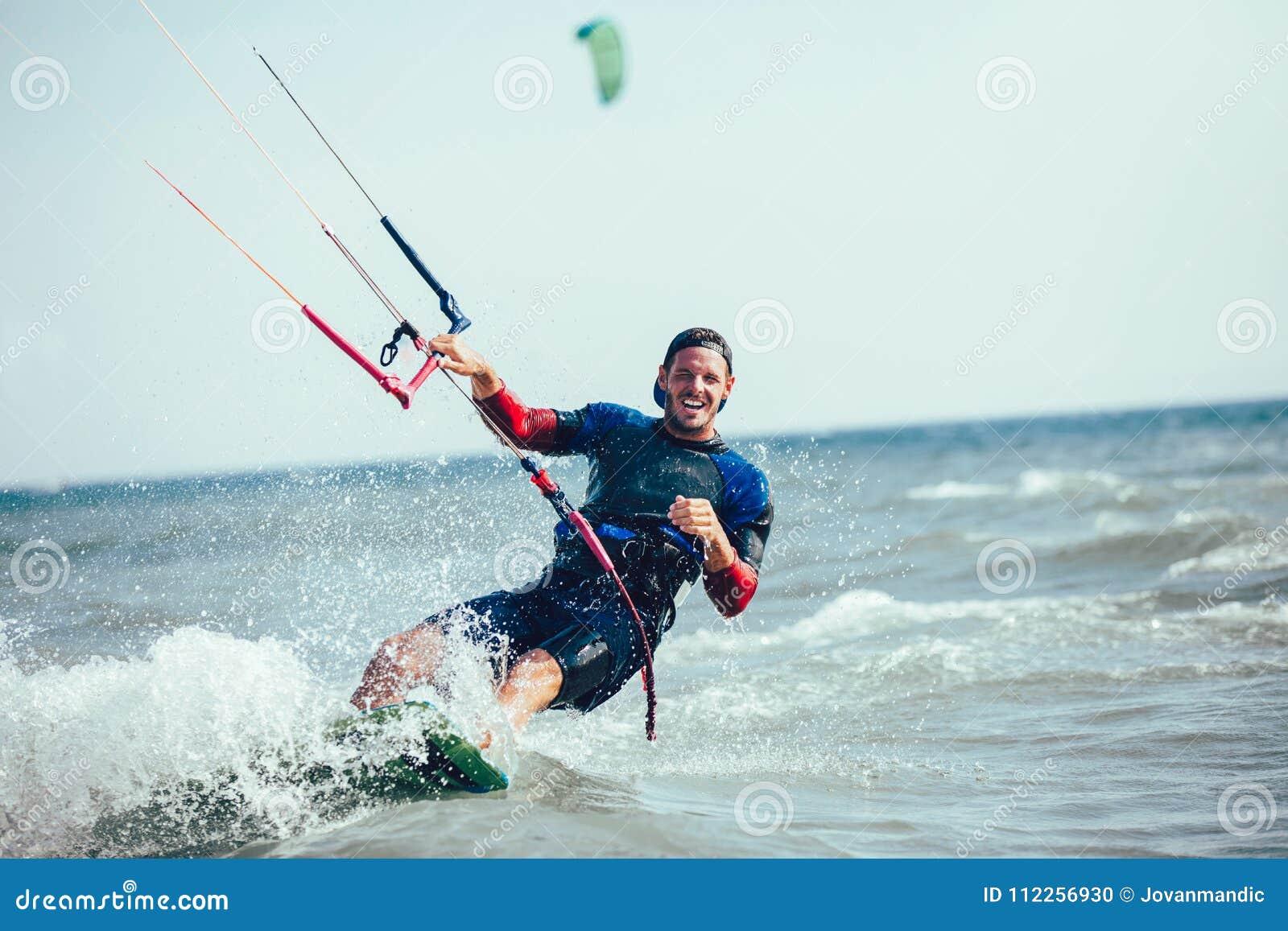 Kitesurfing Kiteboarding action photos man among waves