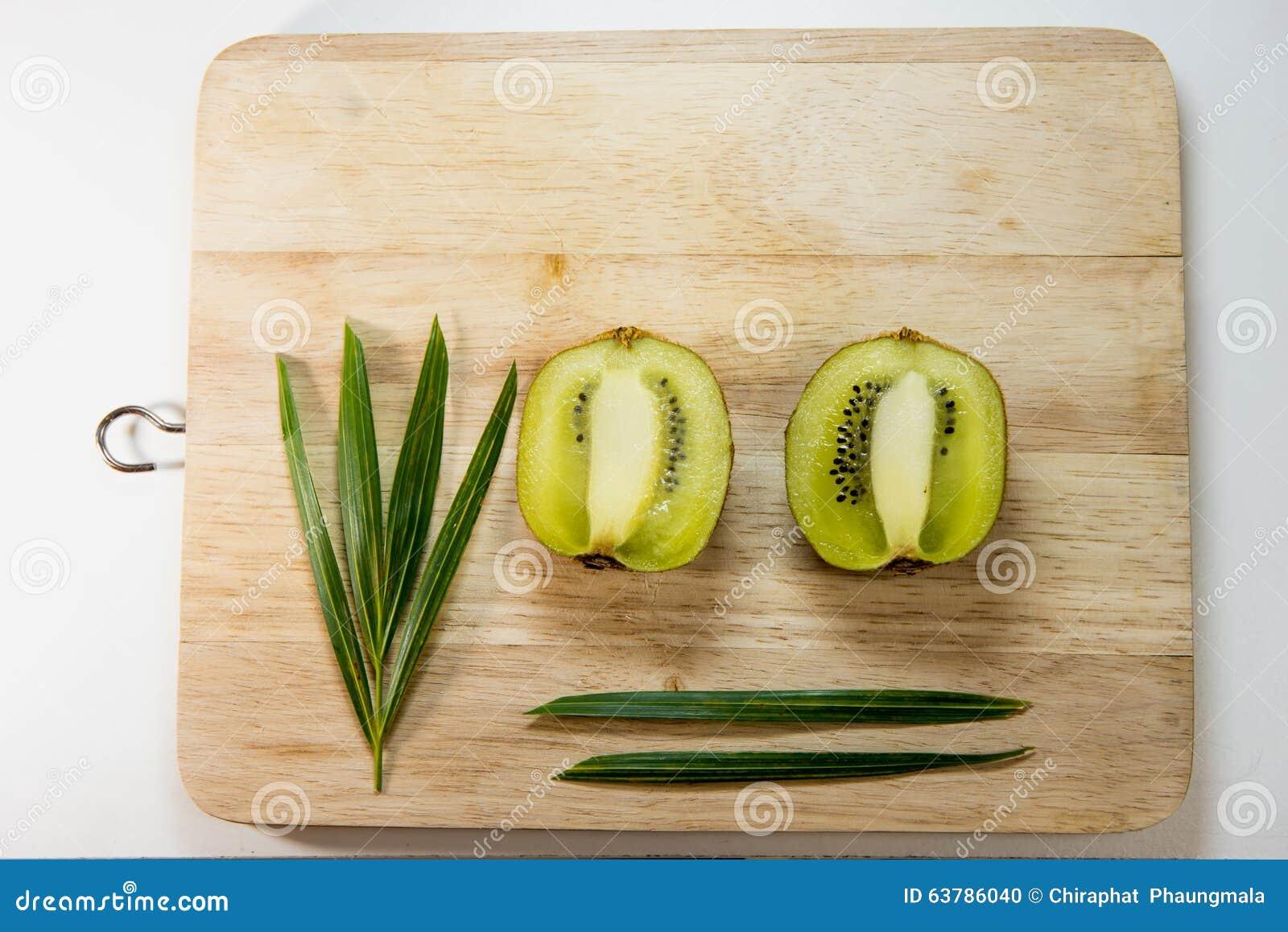 Kiwi fruit isolated on block decoration stock photo for Decoration kiwi