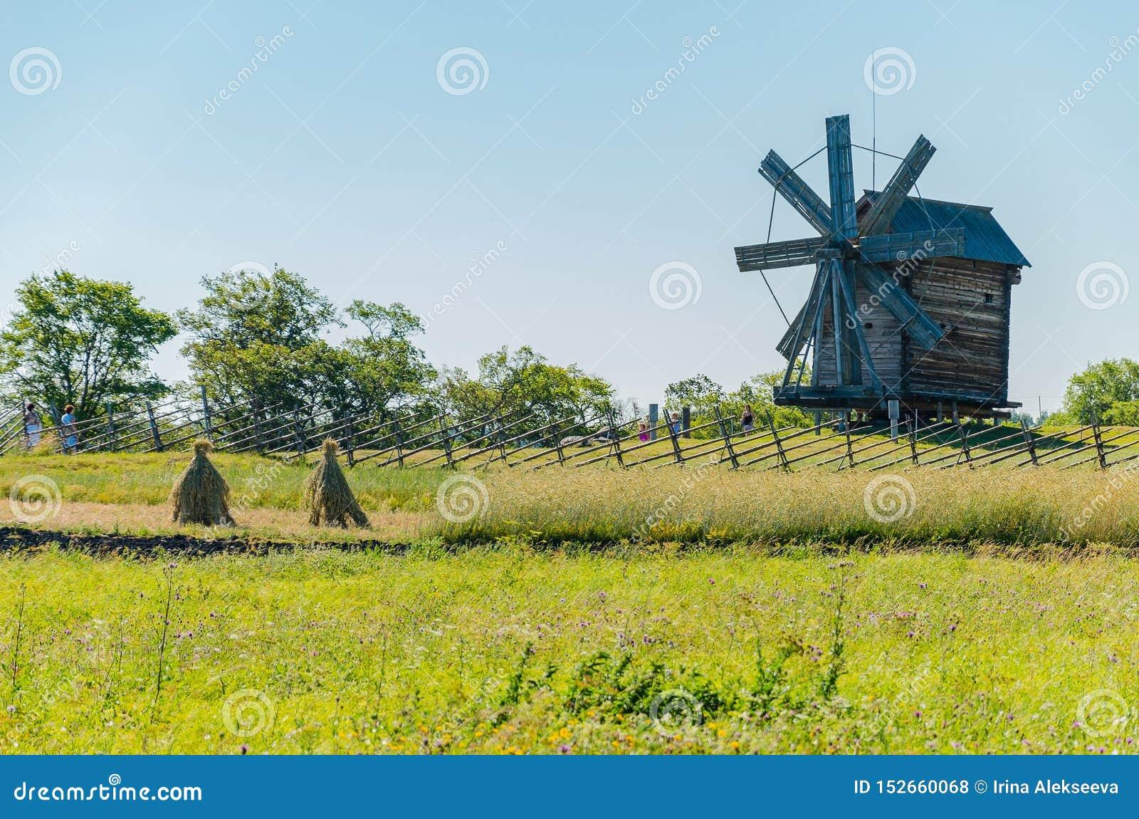 Kizhi Island, Russia - 07.19.2018 -: Old wooden mill. Rural landscape