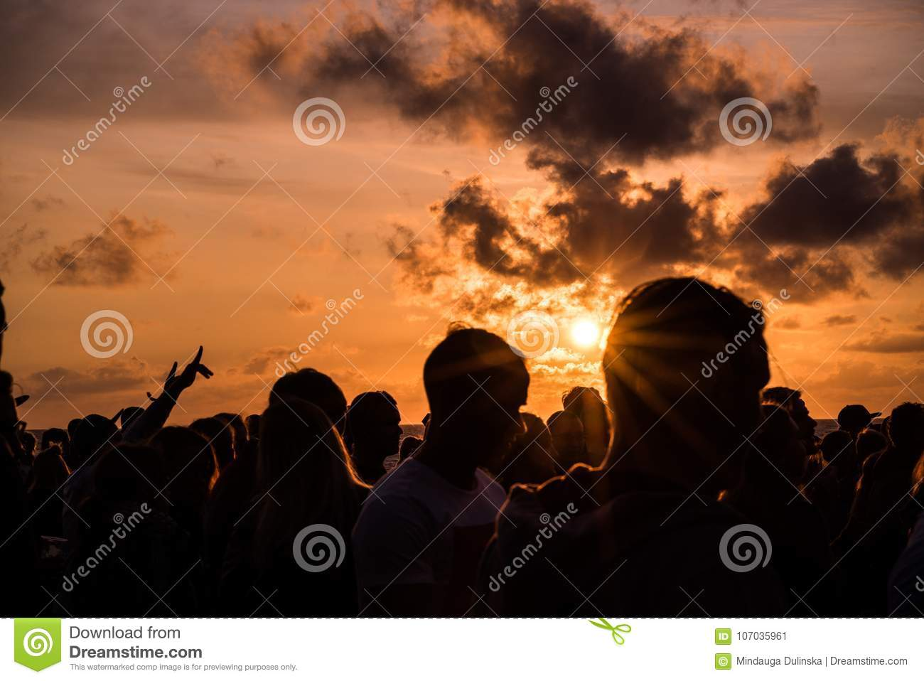 KLAIPEDA, LITHUANIA - AUGUST 19, 2017: Sunset Light with People and Shadows. Sunset at Baltic Sea Beach