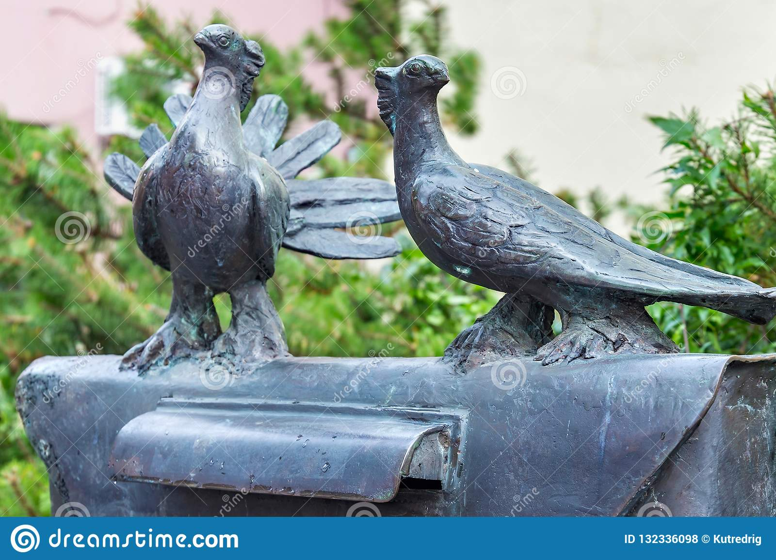 KLAIPEDA, LITHUANIA - SEPTEMBER 22, 2018: Sculptural composition with a mailbox and post pigeons in Klaipeda.