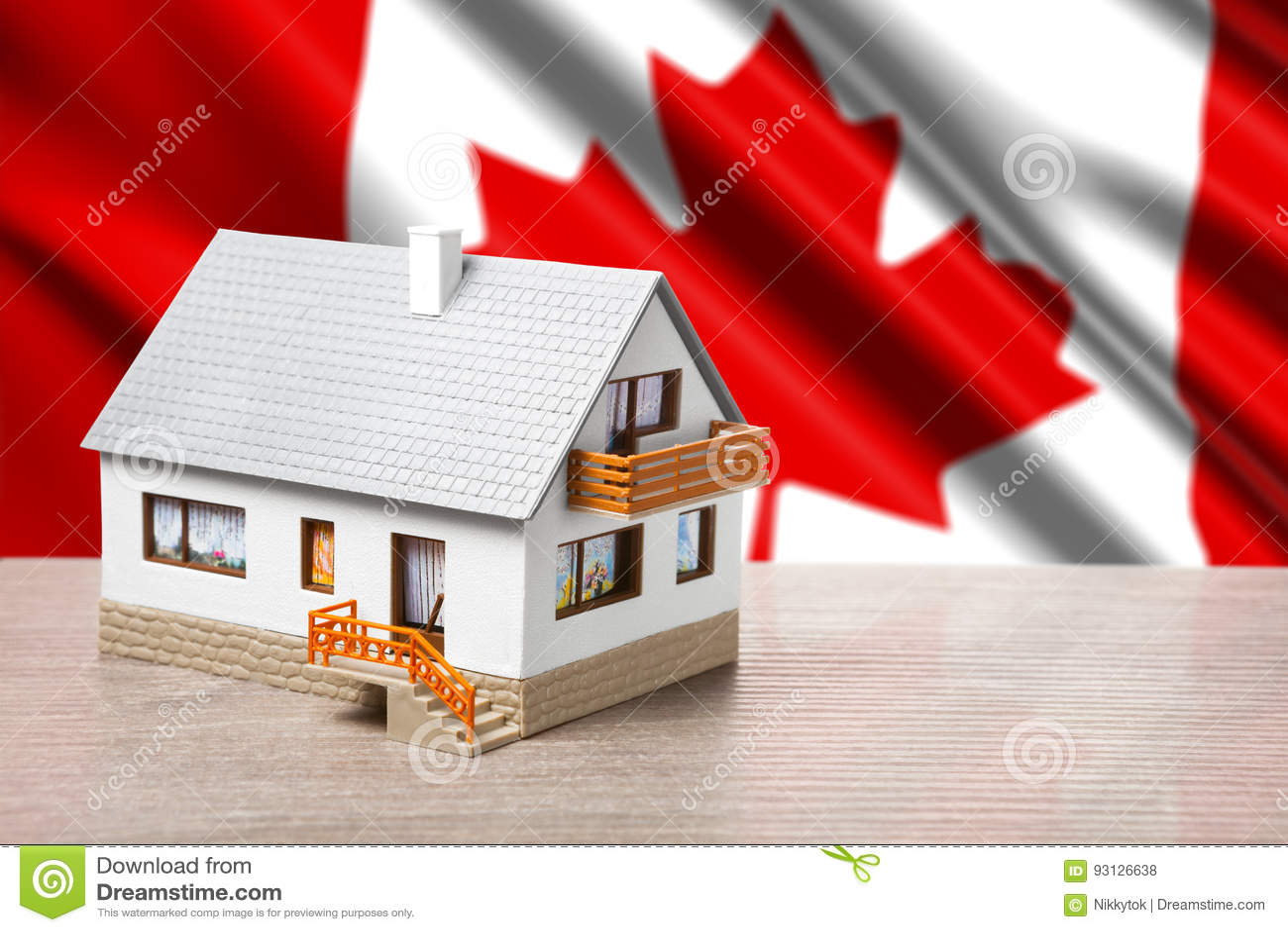 Klassiskt hus mot Kanada flaggabakgrund