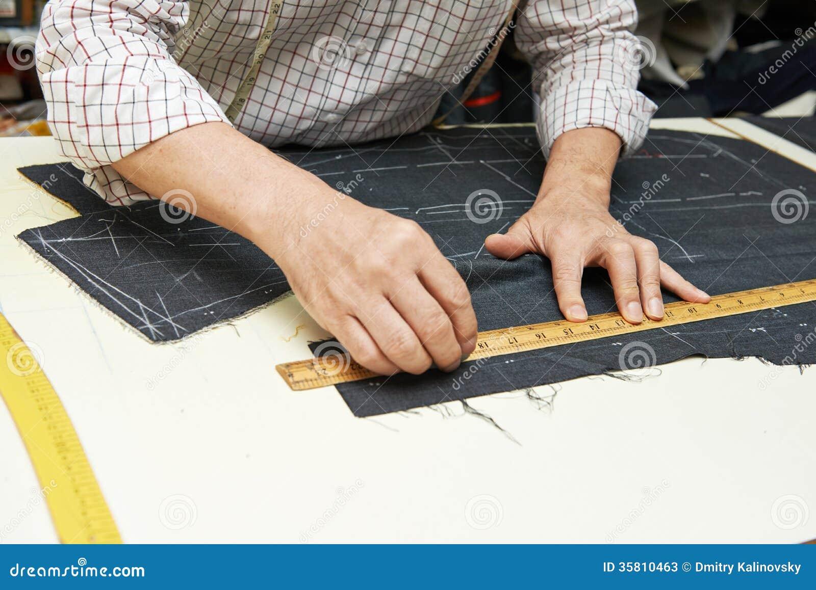 Kleermakershanden op de werk