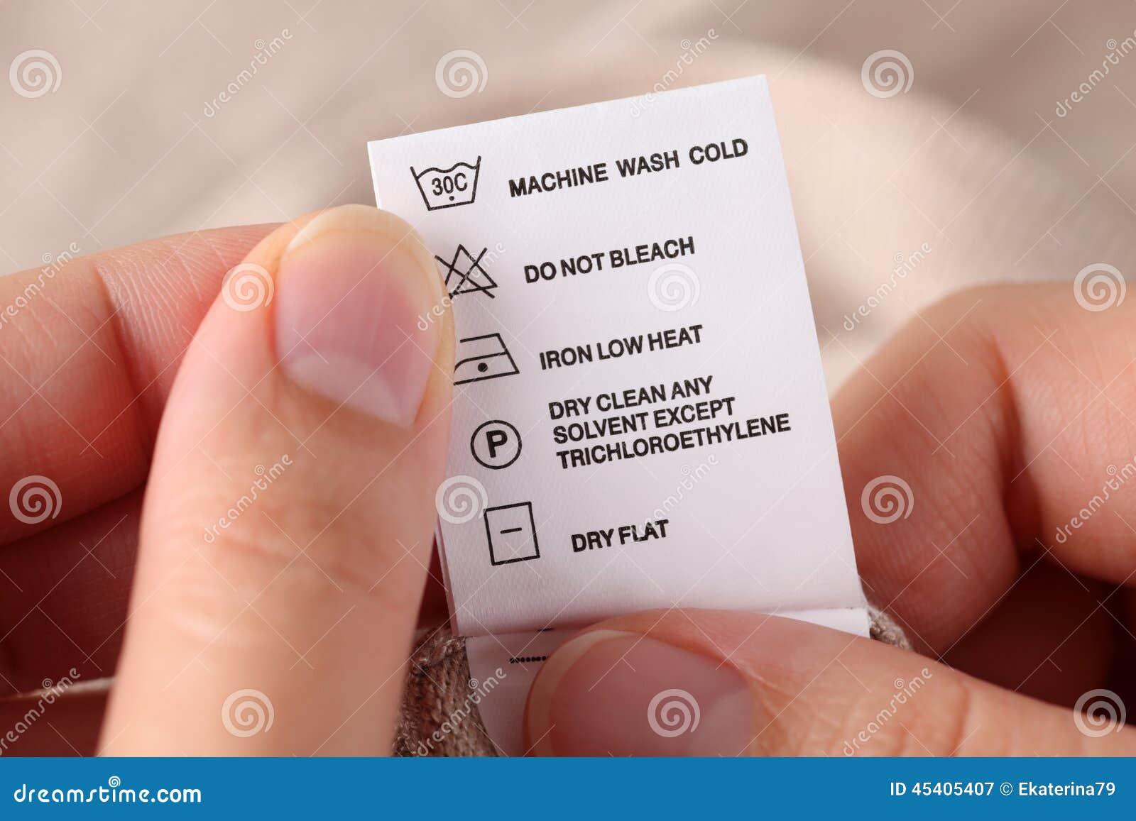 Klerenetiket met het schoonmaken instructies stock foto afbeelding 45405407 - Wrong wash clothesdegrees ...