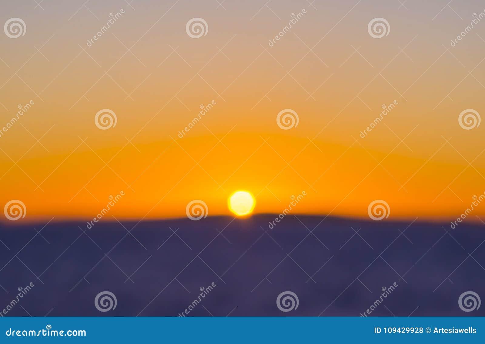 Kleurrijk Zonsondergangonduidelijk beeld