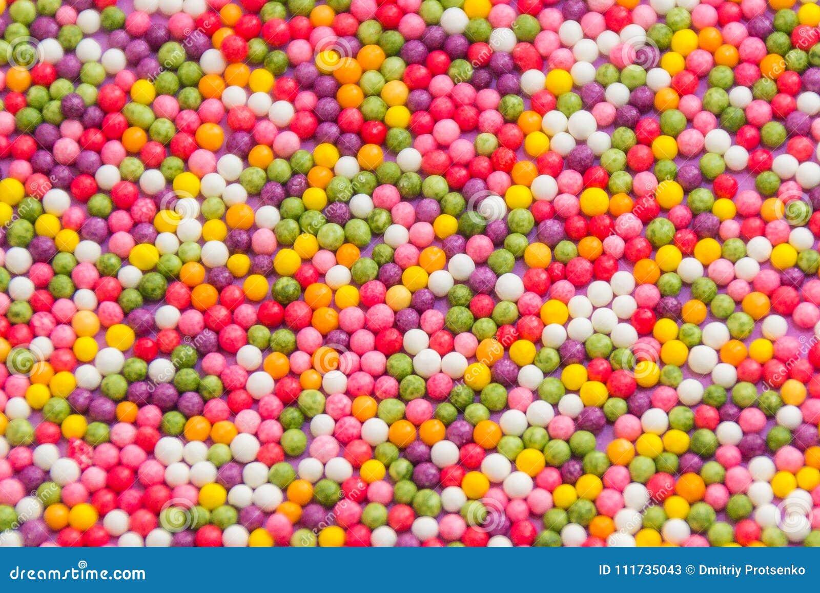 Kleurrijke Achtergrond van multicolored zoete suikergoeddragees Decoratieve Vakantietextuur van verspreid om chocoladebonbons