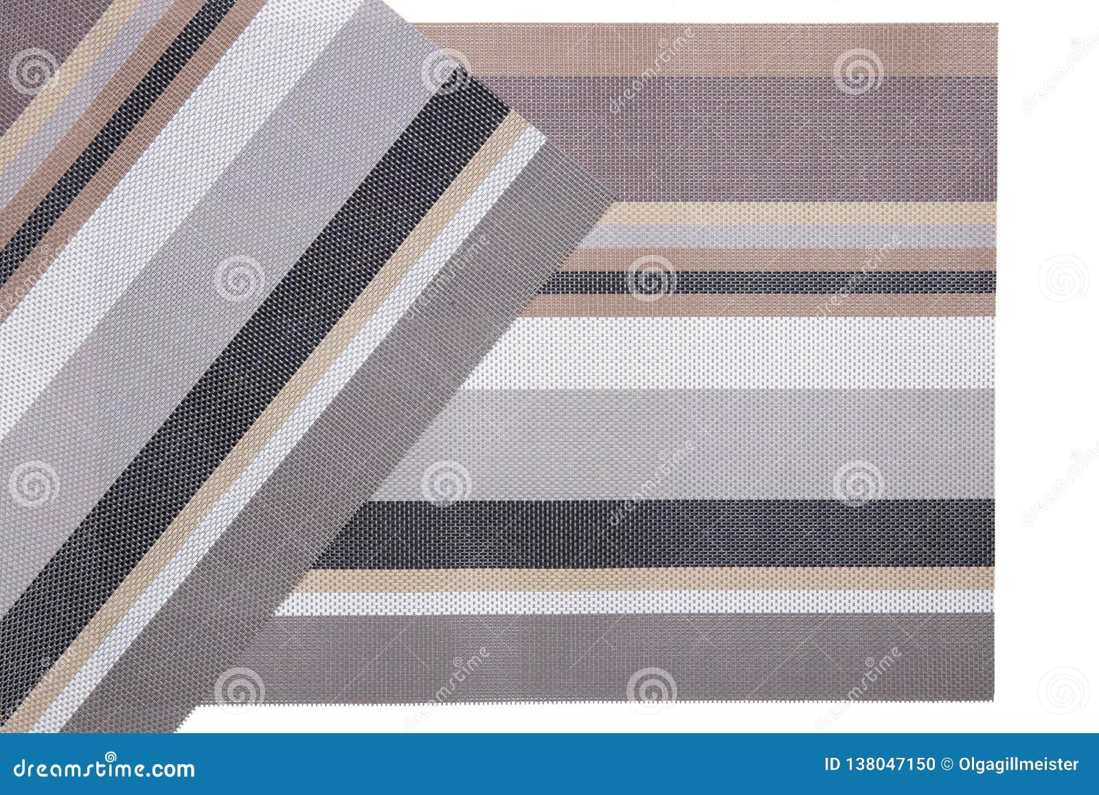 Klingeryt matuje tła Dwa tkanej plastikowej maty z kolorowym pasiastym wzorem odizolowywającym na białym tle