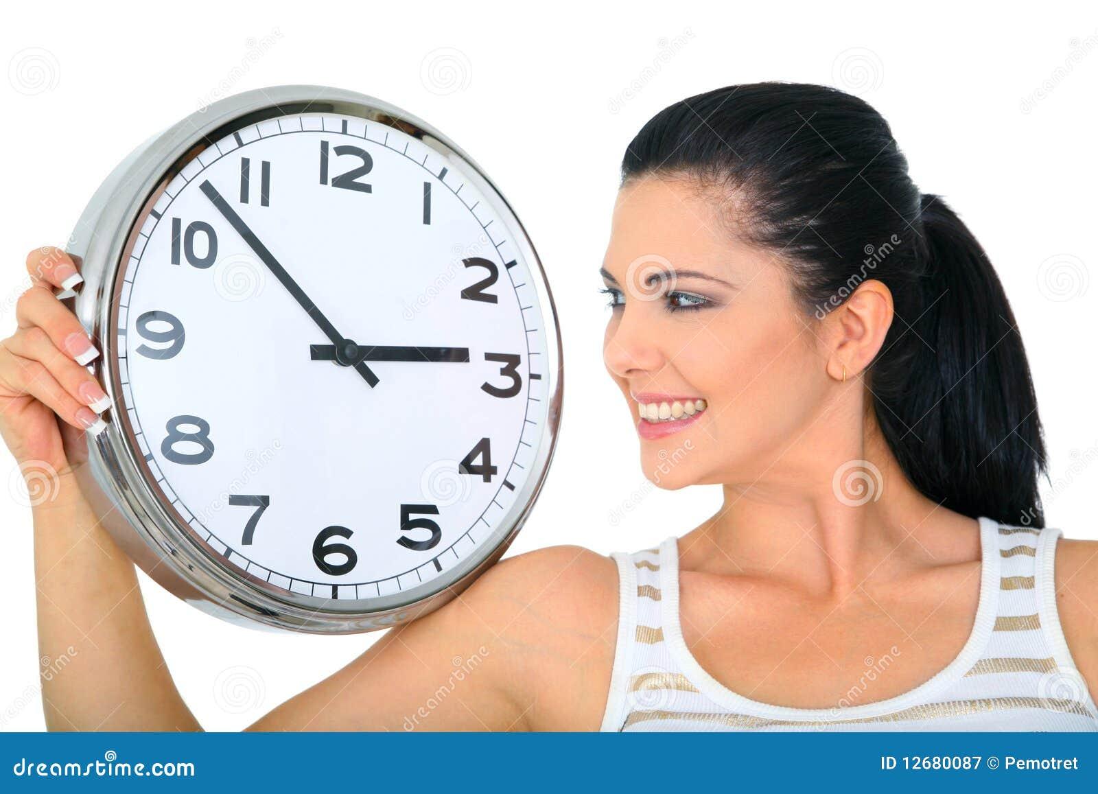 Klocka som ser över kvinna